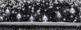 Christmas decoration lights with snow and copy space