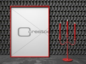 Blank picture frame and red candlestick on black triangulated ba