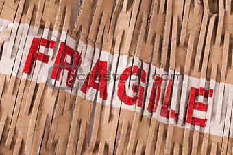 Fragile tape label across packaging