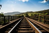 Sunny Mountainous Rail Bridge in Wilderness