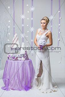 Beautiful winter bride with wedding cake
