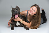 Beautiful girl with grey stafford terrier