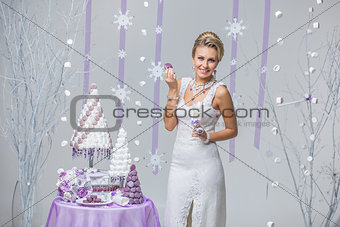 Beautiful winter bride with wedding cake