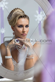 Beautiful bride looking in mirror