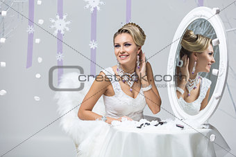 Beautiful bride looking in mirror