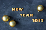background with baked gingerbread words happy new year 2017 and christmas balls. creative idea