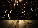 Wooden table with defocussed Christmas image