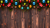 Merry Christmas Frame with real wood green pine and colorful baubles,