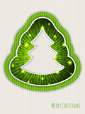 Green christmas greeting with bursting christmas tree