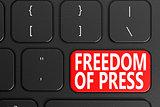 Freedom Of Press on black keyboard