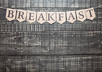 Breakfast sign with paper letter on wooden table