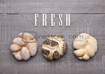 Fresh bread rolls for breakfast morning on wood