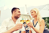 happy couple drinking wine at open-air restaurant