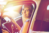 happy woman inside car in auto show or salon
