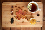 cup of lemon tea and honey on wooden board