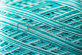close up of turquoise knitting yarn ball