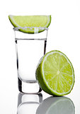 Silver tequila shot glass with lime slice and salt