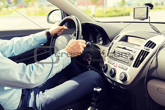 close up of young man driving car