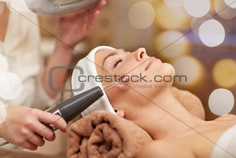 close up of young woman having face massage in spa