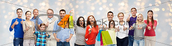 happy people with shopping bags showing thumbs up
