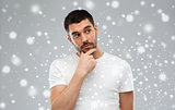 man thinking over snow background
