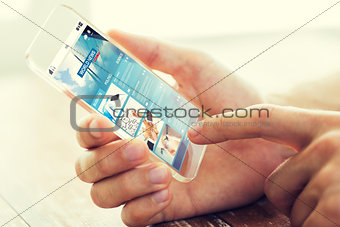 close up of male hand with world news smartphone