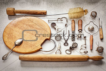 Old pieces of kitchen utensils on a table