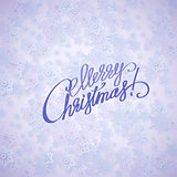 Merry christmas handwritten text on background with snowflakes