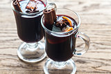 Two glasses of mulled wine on the wooden background