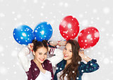 happy teenage girls with helium balloons over snow