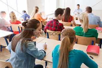 group of students writing school test