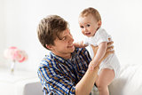 happy young father with little baby at home