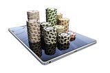 poker chips on modern tablet