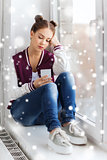 sad pretty teenage girl with smartphone texting