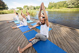people making yoga and meditating outdoors