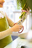 close up of woman with flowers and scissors