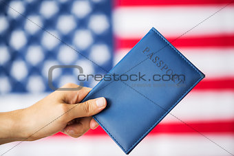 close up of hand with american passport