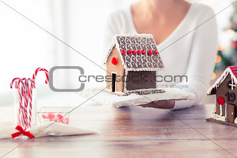 close up of woman showing gingerbread house