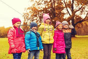 group of happy children in autumn park