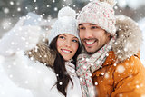 happy couple taking selfie by smartphone in winter