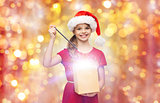 girl in santa hat with gift box and magic wand