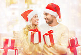 happy couple at home exchanging christmas gifts