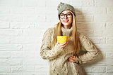 Happy Hipster Fashion Girl in Winter with a Mug