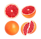 Collection of whole grapefruit and slices isolated on white background
