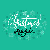 Gold handwritten calligraphic inscription Christmas Magic with pattern of green confetti and snowflakes. Holiday lettering. EPS10