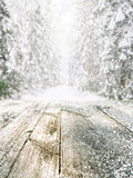 Wooden table in winter forest