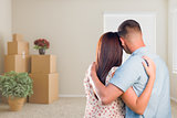 Military Couple Facing Empty Room with Packed Moving and Potted