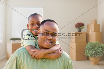 African American Father and Son In Room with Packed Moving Boxes