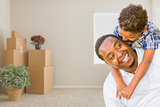 Mixed Race African American Father and Son In Room with Packed M