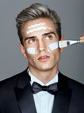 Fashion man with cosmetic cream treatment on his face.